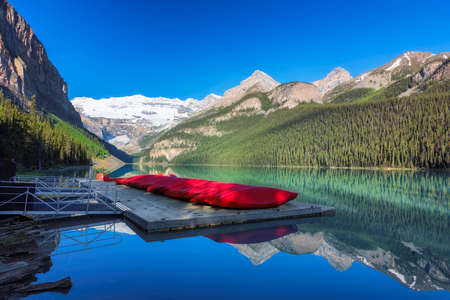 Beautiful sunrise under turquoise waters of the Lake Louise in Canadian Rockies, Banff National Park, Canada