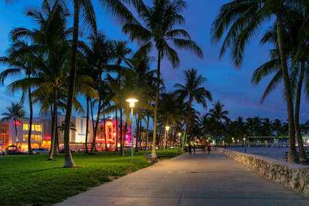Hotels and restaurants at night on Ocean Drive, world famous destination. Nightlife in Miami Beach, Florida.