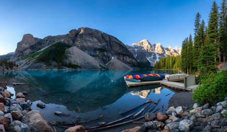 Beautiful panorama of the Moraine lake at sunrise in Canadian Rockies, Banff National Park, Canada