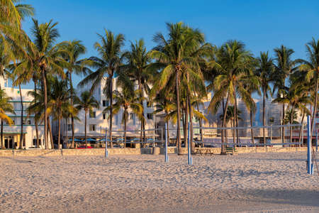 Beach area at morning, hotels and restaurants at sunrise in Ocean Drive, Miami Beach, Florida.