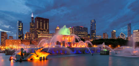 Buckingham fountain and Chicago downtown with skyscrapers at night, Chicago, Illinois, USA.