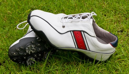 golf shoes on green grass field  Stock Photo