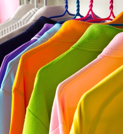 shirts on hangers: colorful t-shirt on the hangers Stock Photo