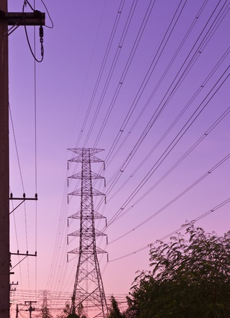 Electric high voltage power post with beautiful sky photo