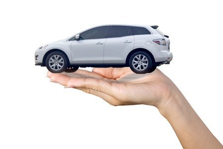 purchases: White sport suv in hand isolated on white Stock Photo