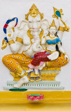 low relief: Indian God Ganesha or Hindu God Name Shakti Ganapati avatar image in stucco low relief technique with vivid color,Wat Samarn temple,Thailand.