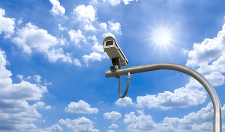 Outdoor Security cctv cameras under Sun shine and White cloud in blue sky Stock Photo - 10455681