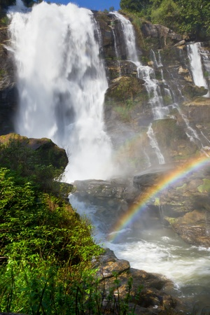 Waterfall in Thailand with real two rainbow photo