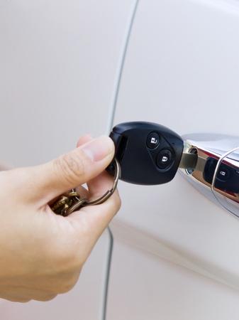 Black car key in hand