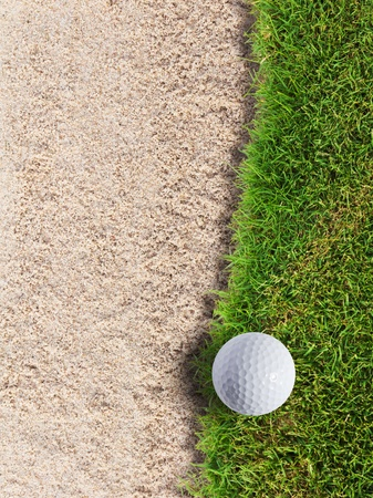 Golf ball on green grass near sand bunker Stock Photo - 12734895