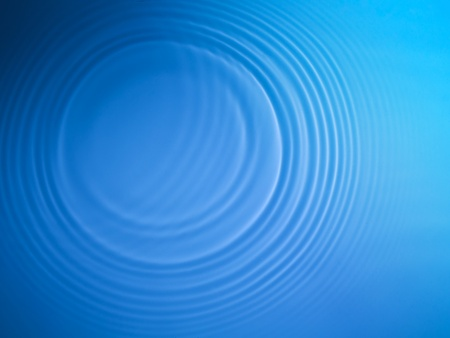 Blue circle water ripple background photo