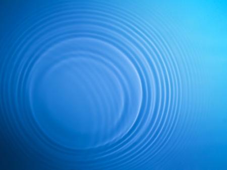 Blue circle water ripple background photo