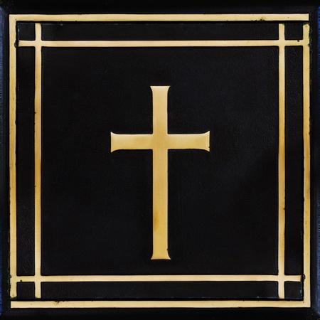 jesuit: Golden cross, symbol of the Christian faith on the black background Stock Photo