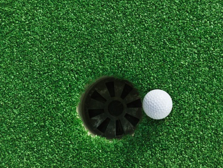 caddie: Golf ball near the hole Stock Photo