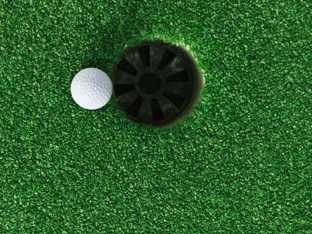 golf green: Golf ball near the hole Stock Photo