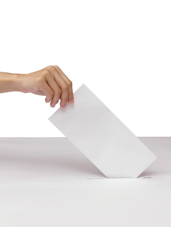 Lady hand putting a voting ballot in slot of white box isolated on white photo