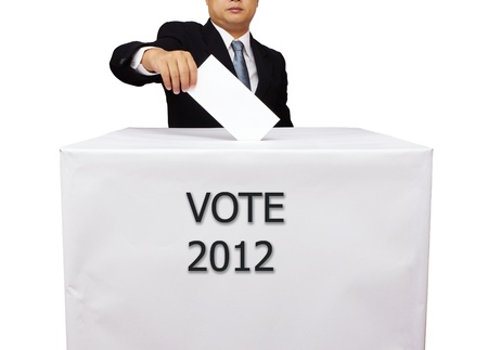 balloting: Gentleman hand putting a voting ballot in slot of white box isolated on white Stock Photo