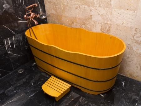 Wooden bathtub in a bathroom photo