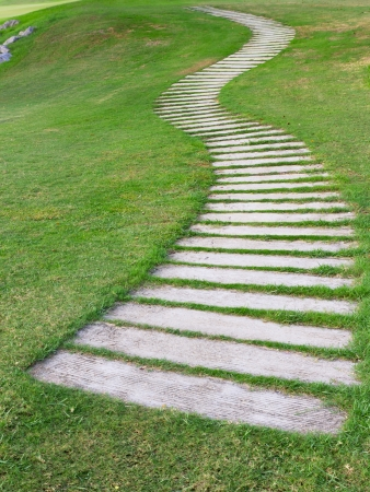 Walkway on green grass in golf club photo