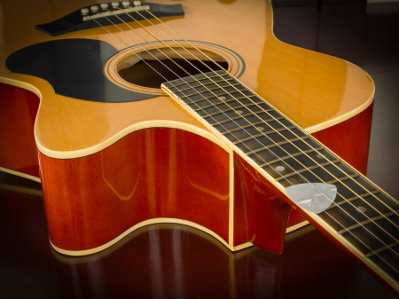 Acoustic guitar on table photo