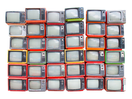 Many old vintage televisions pile up isolated on white background with clipping path Stock Photo