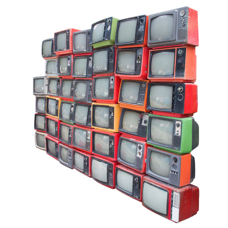 Many old vintage televisions pile up isolated on white background with clipping path photo