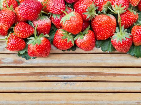 Fresh strawberry on bamboo wood panel