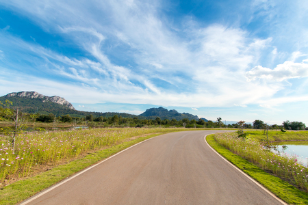Empty curved road with blue sky Stock Photo