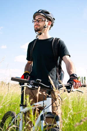 young happy biker photo