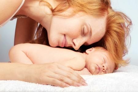 new mothers: newborn sleeping baby