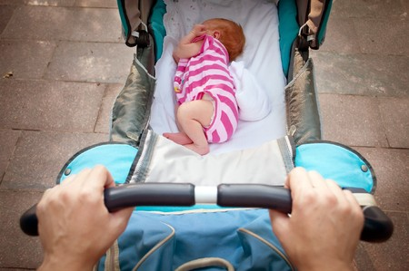 sleeping newborn baby in the pram photo