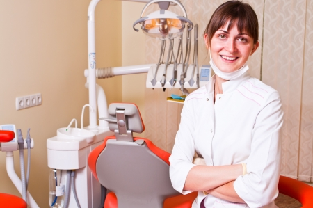 dentists: Young dentist in her office looking at the viewer Stock Photo