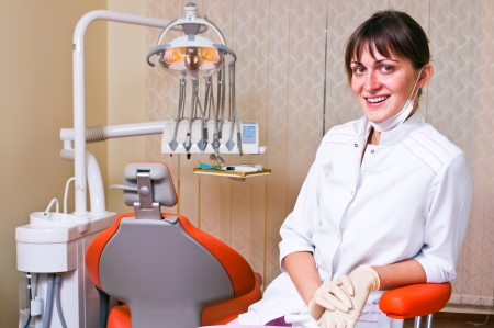dental practice: Young dentist in her office looking at the viewer Stock Photo
