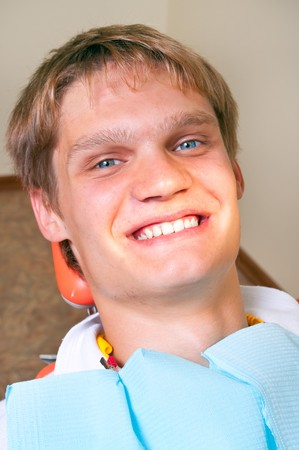 Happy patient in dental chair Stock Photo - 7762022