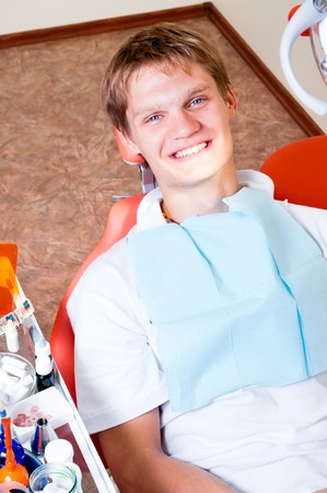 Happy patient in dental chair Stock Photo - 7761921