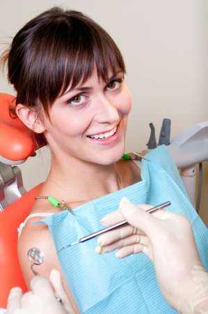gloves nurse: Happy patient in dental chair