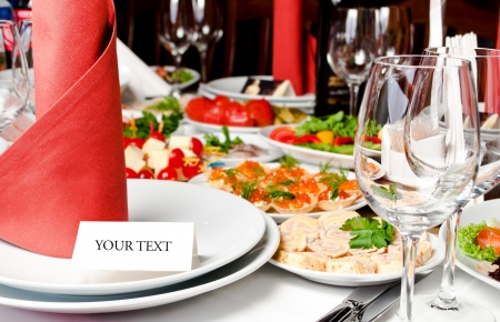 closeup of a banquet table with invitation card photo