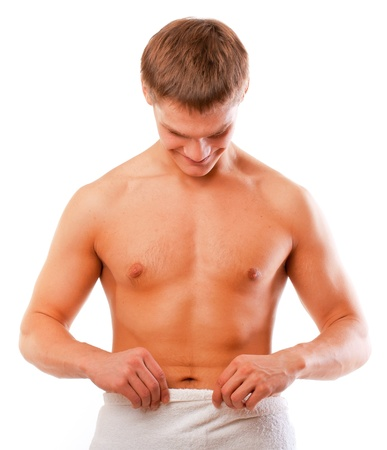 pene: Feliz joven mirando su pene aislado sobre blanco