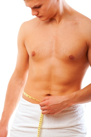 Young man measuring his waist Stock Photo - 8475104