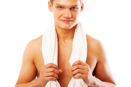 Portrait of a young man holding white towel  photo