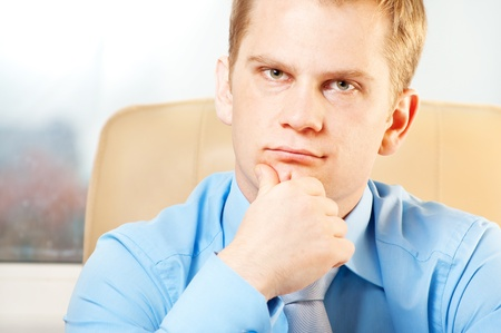 portrait of a young  thoughtful businessman in doubt about something photo