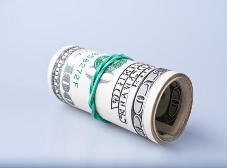 Money roll with US dollars bills photo