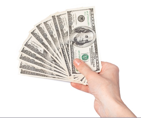 Hand giving dollars banknotes isolated on the white background photo