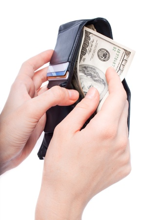 personal finance: hands taking money from open wallet isolated