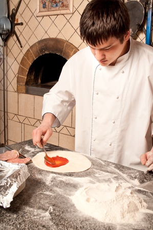 pizza base: Close up of Chef making a Pizza Base