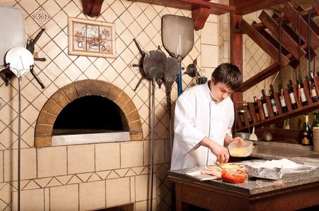 preparing dough: A chef in a process - preparing pizza