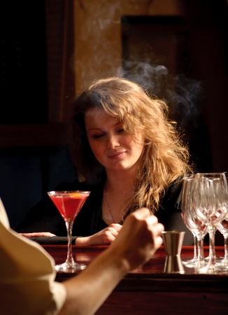 A beautiful woman at the cocktail bar photo