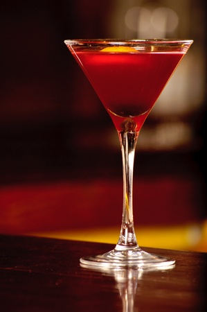 A glass with the red citrus cocktail photo