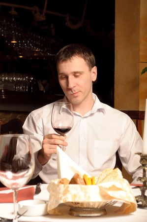A man at the restaurant with red wine photo