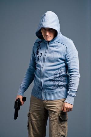The aggressive bandit with gun photo
